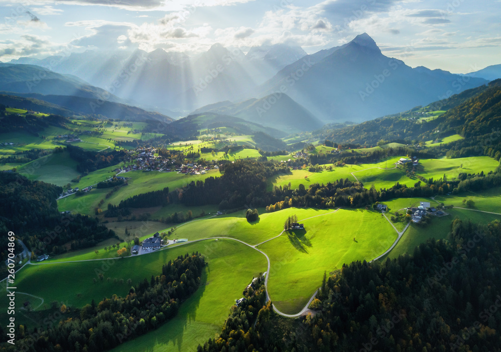 Fototapety, obrazy: Aerial shot of sun rays above the spring green meadows