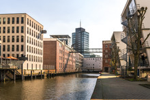 Urban Development In The Harburg Inland Port. Old Converted Warehouses And New Office Buildings In The Harbour. The City And The District Are Part Of The Federal State Of Hamburg