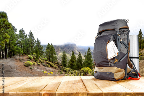 Foto auf Leinwand Camping Backpack and mountains landscape
