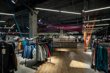 Modern Clothes Shop With Large Selection Of Different Wear And Shoes