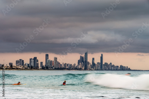 Surfers surfing at Gold Coast Canvas Print