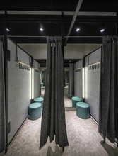 Interior Of Modern Clothes Shop With Fitting Room
