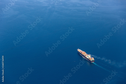 Valokuvatapetti Cargo vessel at sea
