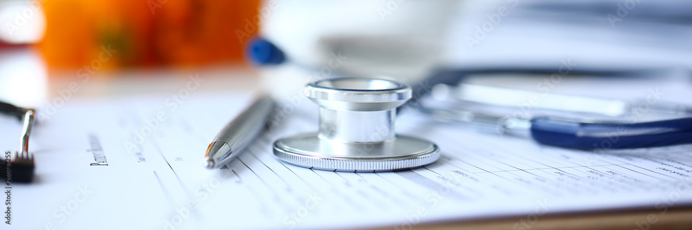 Fototapety, obrazy: Stethoscope head and silver pen lying on medical application form