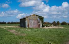 Old Rusty Corrugated Iron Barn In Field