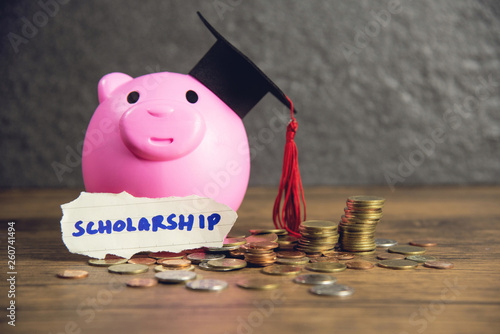 Fotografering  Education concept with money coin and graduation cap on pink piggy bank saving m