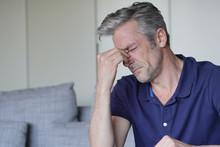 Mature Man With Bad Headache A...