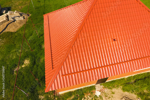 Foto  House with an orange roof made of metal, top view