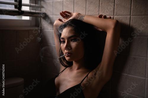 Sexy concept  Sensual women are sucking cigarettes in the