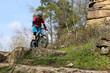 Mountain biker in difficult terrain