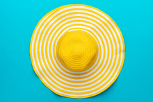 Top View Of Yellow Hat On Blue Background