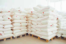 Folded White Bags On Pallets In Factory Storage.