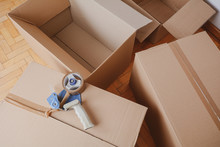 Tape Dispenser Sealing A Shipping Cardboard Box