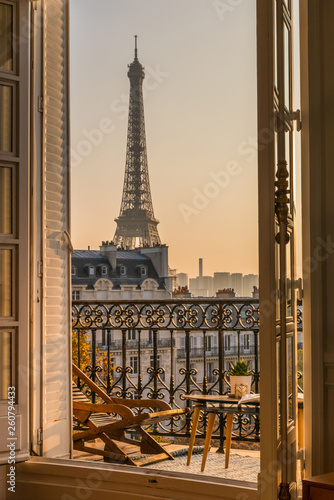 Poster Eiffeltoren beautiful paris balcony at sunset with eiffel tower view