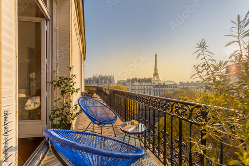 Poster Paris beautiful paris balcony at sunset with eiffel tower view