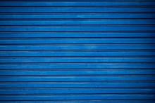 Old Blue Shuttered Roll Up Metal Door.