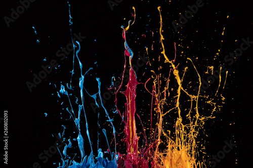 Macro photo of mixed acryl colors on black Canvas Print