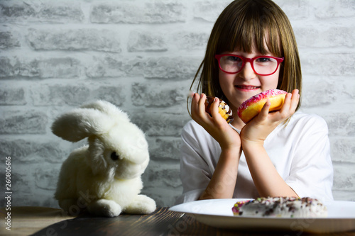 Photo  Child is having fun with donuts