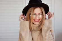 Charming Young Girl In A Stylish Hat And Glasses. Young Woman Wearing Braces And Smiling