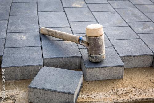 Fototapeta Concrete paver blocks laid with rubber hammer