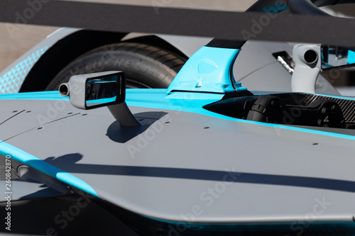 Rome, Italy 2019, March 30th. E-Prix, Formula E. Details of hihg speed electric racing car, carbon and fibreglass textures, blue paint. Extreme sports, design concept, small mirror.