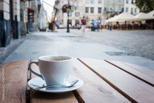 Coffee cup on a table of typical European outdoor cafe Canvas Print