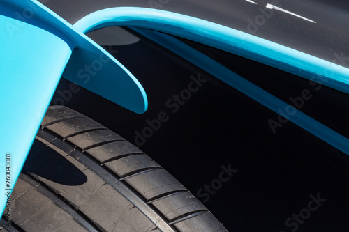 Rome, Italy 2019, March 30th. E-Prix, Formula E. Details of hihg speed electric racing car, carbon and fibreglass textures, blue paint. Extreme sports, design concept, engineered rubber tires.
