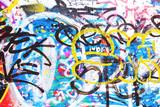 Fototapeta Młodzieżowe - Closeup of texture damaged colorful graffiti wall