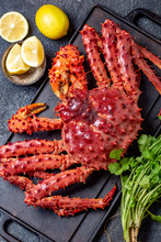 Red King Crab On Gray Background. King Crab, Lemon And Cilantro, Top View
