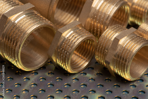 Stampa su Tela Plumbing fittings close-up on metallic background
