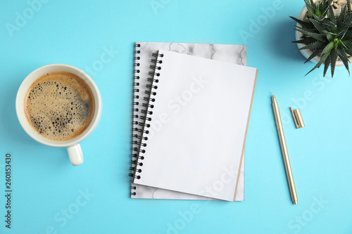 Flat lay composition with notebooks and coffee on color background Wallpaper Mural