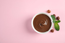 Dessert Bowl With Sweet Chocolate Cream, Hazelnuts And Mint On Color Background, Top View. Space For Text