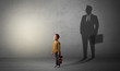 canvas print picture Little boy imagine that he will be businessman and illustrating his future in a big shadow
