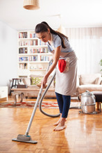 Beautiful Housewife Making Vacuum Cleaning At Home