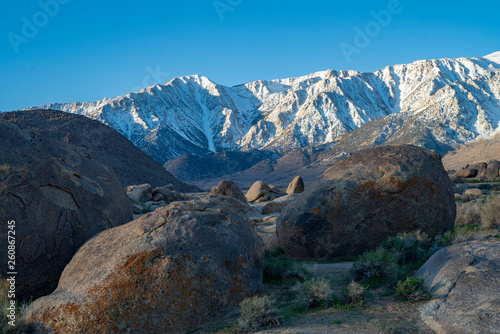 rock formations in front of snowy mountain peaks Sierra Nevada California Alabama Hills