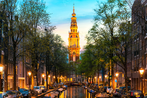Poster Amsterdam Amsterdam Zuiderkerk church tower at the end of a canal in the city of Amsterdam, Netherlands at night .