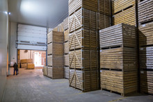 Potatoes Storage. Crops Warehouse. Dry Cool Storage. Stacked Wooden Crates With Potatoes.