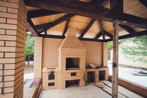 beautiful wooden terrace with fireplace on the street. Wallpaper Mural