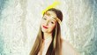 Pretty girl wearing golden band with feathers and smiling to the camera