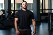 Muscular Man Posing In Black T-shirt