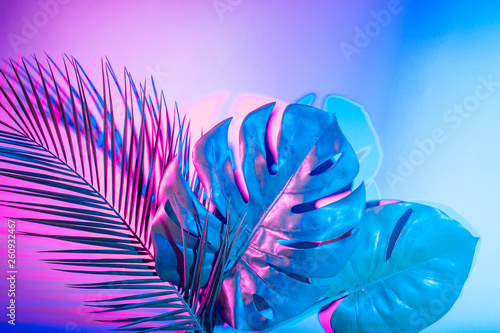 Tropical leaves in vibrant bold gradient holographic neon colors