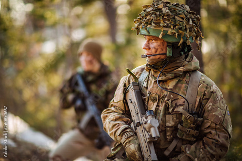 Obraz British special forces soldier with weapon take part in military maneuver. war, army, technology and people concept. - fototapety do salonu