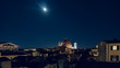 Moonlight sky over Firenze's skyline with dome landmark on a bright night in Tuscany, Italy