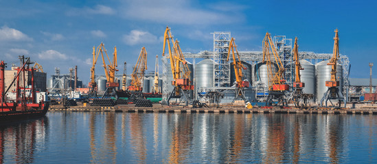 Lifting cargo cranes, ships and grain dryer in Sea Port of Odessa, Black Sea, Ukraine