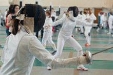 Fencing Tournament. A Girls Holding A Saber In The Hall