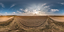 Full Seamless Spherical Panorama 360 Degrees Angle View Near Gravel Road Among Meadow Fields In Spring Evening Sunset With Awesome Clouds In Equirectangular Projection, VR AR Virtual Reality Content