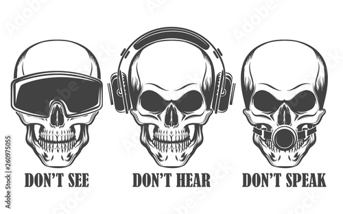 Fotografia Three human skulls in headphones, virtual reality headset and ball gag