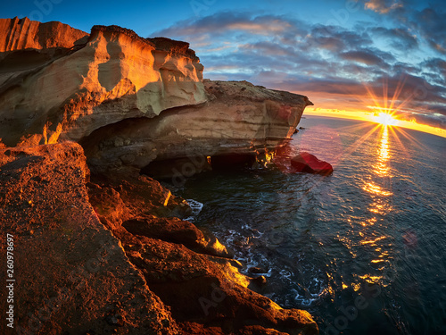 Spoed Foto op Canvas Canarische Eilanden Rocky coast of San Miguel del Tajao of the southeast part of Tenerife at sunrise in the Spanish Canary Islands