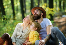 Happy Son With Parents Relax In Autumn Forest. Mother, Cowboy Father Love Their Little Boy Child. Spring Mood. Happy Family Day. Sunny Weather. Healthy Food. Family Picnic. Spring Everywher
