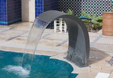 Decorative Fountain In The Swimming Pool
